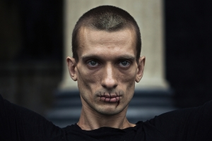 "Pyotr Pavlensky, ""Stitch"", 2012. Photo: Gleb Haski/ Calvert Journal"
