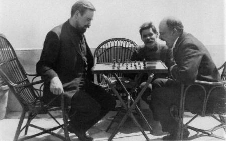 Bogdanov playing chess with Lenin in Capri, Italy, April 1908. Maxim Gorky is watching. Photo by Yu.A. Zhelyabuzhsky. Source: monoskop.org.