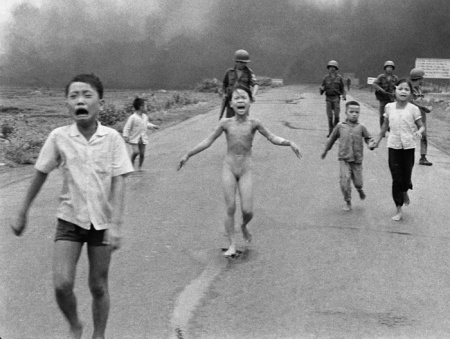 The photo Facebook banned: On 8 June 1972, crying children, including 9-year-old Kim Phuc, centre, run down Route 1 near Trang Bang, Vietnam after an aerial napalm attack. From left, the children are Phan Thanh Tam, younger brother of Kim Phuc, who lost an eye, Phan Thanh Phouc, youngest brother of Kim Phuc, Kim Phuc, and Kim's cousins Ho Van Bon, and Ho Thi Ting. Photo Nick Ut/AP. (http://www.ap.org/Content/AP-In-The-News/2012/AP-napalm-girl-photo-from-Vietnam-War-turns-40)