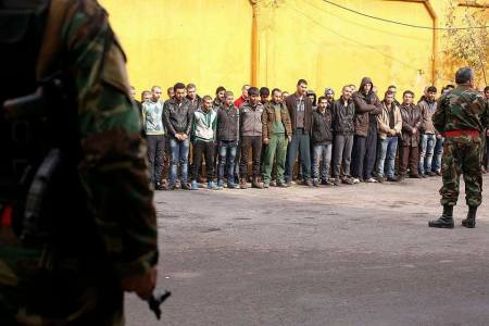 Young men under arrest in eastern Aleppo, 13 December. Photo from Day of Solidarity With Syria.