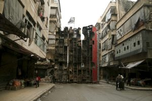 A barricade in Aleppo. Photo by Reuters